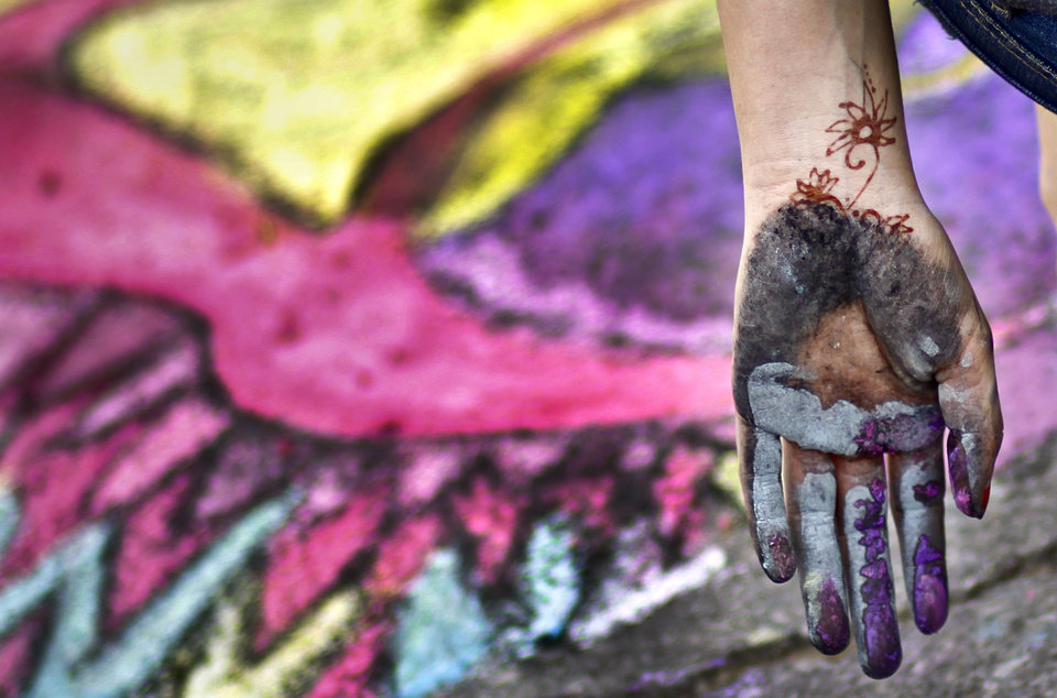 An artist's hands show the labor of creating sidewalk chalk artwork during the Montmartre Sidewalk Chalk Festival at the University of Science and Arts of Oklahoma on Thursday, April 7, 2011, in Chickasha, Okla. Photo by Chris Landsberger, The Oklahoman