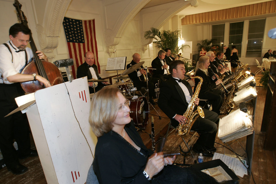 Photo - Members of the Al Good Orchestra of Oklahoma City, perform at the Oklahoma Centennial Statehood Inaugural Ball, Saturday, Nov. 17, 2007, at the Guthrie Scottish Rite Masonic Center, in Guthrie, Okla. By Bill Waugh, The Oklahoman