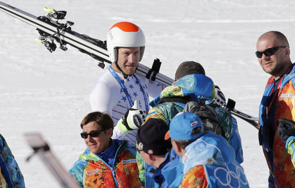 Photo - United States' Bode Miller talks to Olympic staff after a men's downhill training run for the Sochi 2014 Winter Olympics, Saturday, Feb. 8, 2014, in Krasnaya Polyana, Russia. the 2014 Winter Olympics, Saturday, Feb. 8, 2014, in Krasnaya Polyana, Russia. (AP Photo/Christophe Ena)
