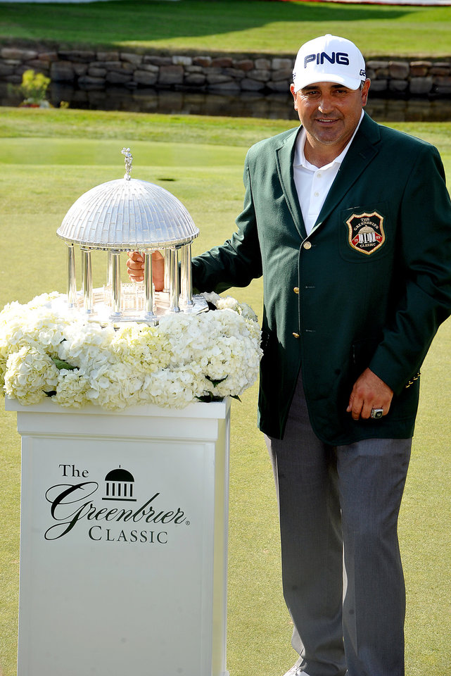 Photo - Angel Cabrera with The Greenbrier Classic Springhouse Trophy after winning the Greenbrier Classic golf tournament at the Greenbrier Resort in White Sulphur Springs, W.Va., Sunday, July 6, 2014  (AP Photo/Chris Tilley)
