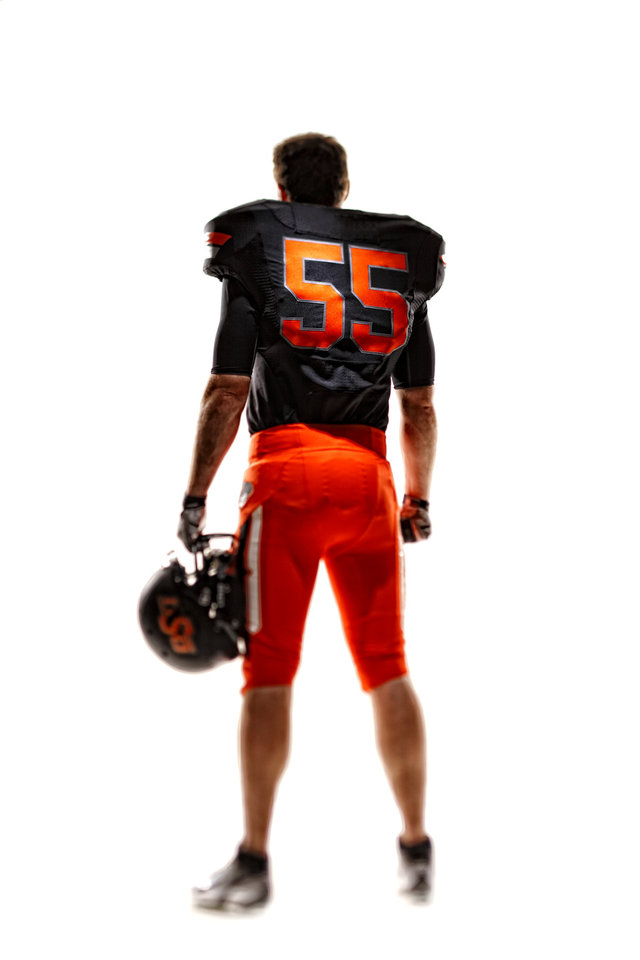Photo - Oklahoma State's new football uniforms. Pictured here are the orange pants, black jersey and the black helmet. PHOTO PROVIDED