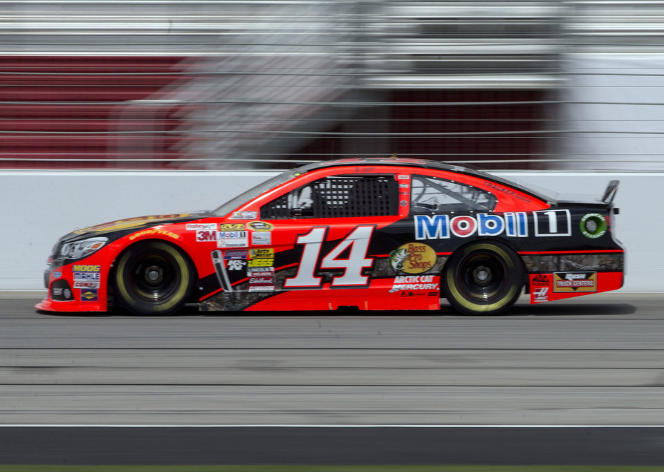 Photo - NASCAR driver Tony Stewart practices for Sunday's NASCAR auto race at Atlanta Motor Speedway in Hampton, Ga., Friday, Aug. 29, 2014. Sunday's race will be his first since his car struck and killed a fellow driver during a sprint race in New York three weeks ago. (AP Photo/John Bazemore)