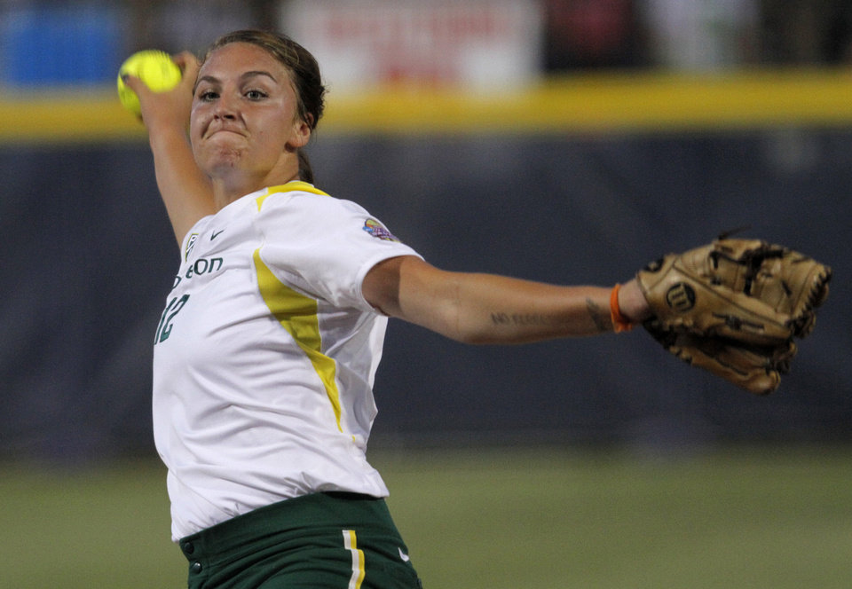 Oregon's Jessica Moore (12) pitches during a Women's College World Series game between California and Oregon at ASA Hall of Fame Stadium in Oklahoma City, Saturday, June 2, 2012. Photo by Garett Fisbeck, The Oklahoman