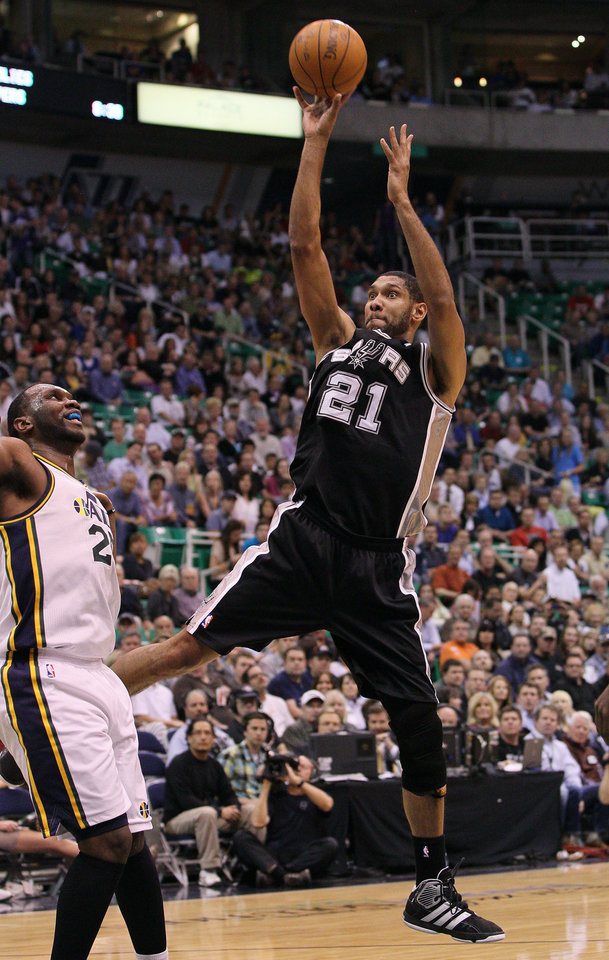 Photo -   San Antonio Spurs center Tim Duncan (21) attempts a shot as Utah Jazz center Al Jefferson (25) defends during the first half of Game 4 in the first-round NBA basketball playoff series, Monday, May 7, 2012, in Salt Lake City. (AP Photo/Colin E Braley)