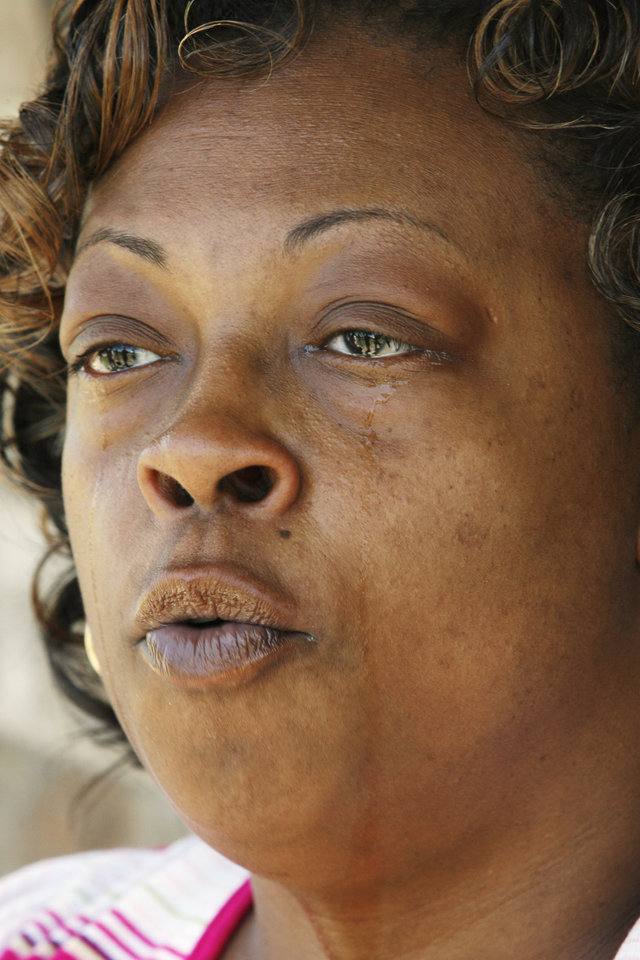 Photo - Cleta Jennings, Antwun Parker's mother, on her sister's front porch talking about Antwun in Oklahoma City Friday, May 29, 2009. Parker, 16, was killed by pharmacist Jerome Jay Ersland during an attempted robbery of Reliable Discount Pharmacy, 5900 S Pennsylvania Ave, on May 19, 2009. Photo by Paul B. Southerland, The Oklahoman