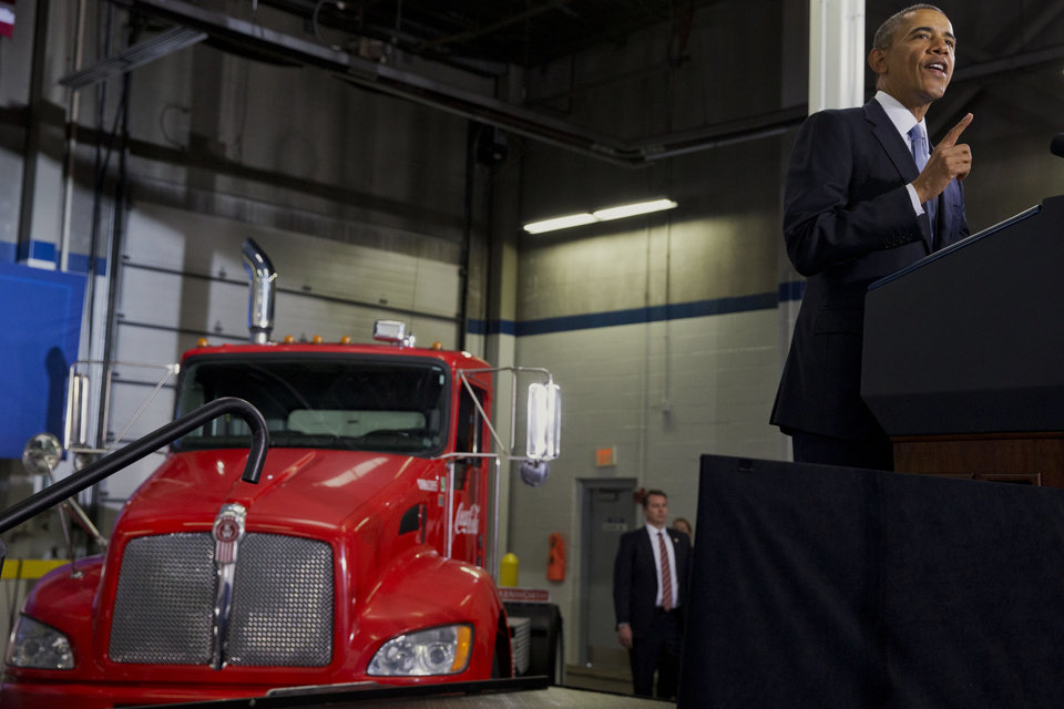Photo - President Barack Obama speaks about how having a fuel-efficient truck fleet can boost the economy and help combat climate change, Tuesday, Feb. 18, 2014, at the Safeway Distribution Center in Upper Marlboro, Md. (AP Photo/Jacquelyn Martin)
