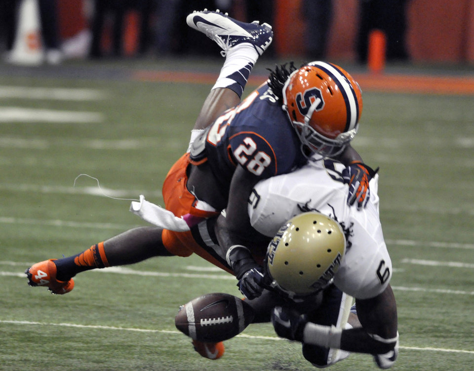 Photo -   Syracuse's Jeremi Wilkes (28) causes Pittsburgh's Drew Carswell to fumble, resulting in a Syracuse touchdown during the first quarter of an NCAA college football game in Syracuse, N.Y., Friday, Oct. 5, 2012. (AP Photo/Kevin Rivoli)