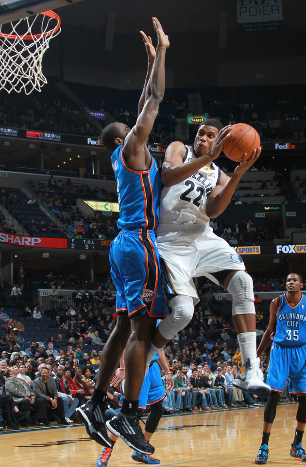 Memphis Grizzlies forward Rudy Gay (22) shoots while defended by Oklahoma City Thunder forward Serge Ibaka, left, in the first half of an NBA basketball game Tuesday, Jan. 10, 2012, in Memphis, Tenn. (AP Photo/Nikki Boertman) ORG XMIT: TNNB101