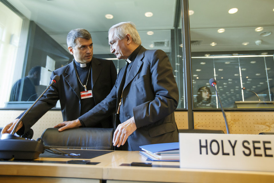 Photo - Archbishop Silvano M. Tomasi, right, Apostolic Nuncio, Permanent Observer of the Holy See (Vatican) to the Office of the United Nations in Geneva, speaks with Monsignor Christophe El-Kassis, left, prior the UN torture committee hearing on the Vatican, at the headquarters of the office of the High Commissioner for Human Rights (OHCHR) in the Palais Wilson, in Geneva, Switzerland, Monday, May 5, 2014. The UN Committee Against Torture hears the Holy See for the first time to consider whether the church's handling of child sexual abuse complaints has violated its obligations against subjecting minors to torture and to hear the Vatican on its efforts to stamp out child sex abuse by priests. (AP Photo/Keystone, Salvatore Di Nolfi)