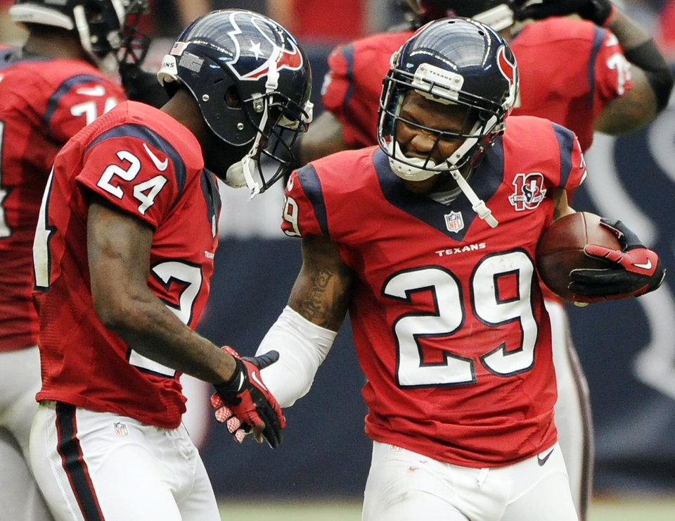 Photo -   Houston Texans strong safety Glover Quin (29) celebrates his interception against the Baltimore Ravens with Johnathan Joseph (24) during the second quarter of an NFL football game, Sunday, Oct. 21, 2012, in Houston. (AP Photo/Dave Einsel)