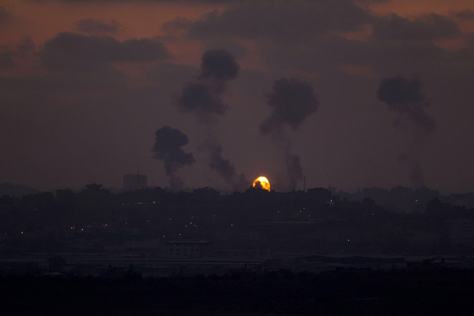 Photo - Israeli strikes on Gaza are seen from the Israel-Gaza Border, Tuesday, July 8, 2014. The Israeli military launched a major offensive in the Hamas-ruled Gaza Strip on Tuesday, striking more than 100 sites and mobilizing troops for a possible ground invasion in what Israel says is an operation aimed at stopping a heavy barrage of rocket attacks from the Palestinian territory.(AP Photo/Ariel Schalit)