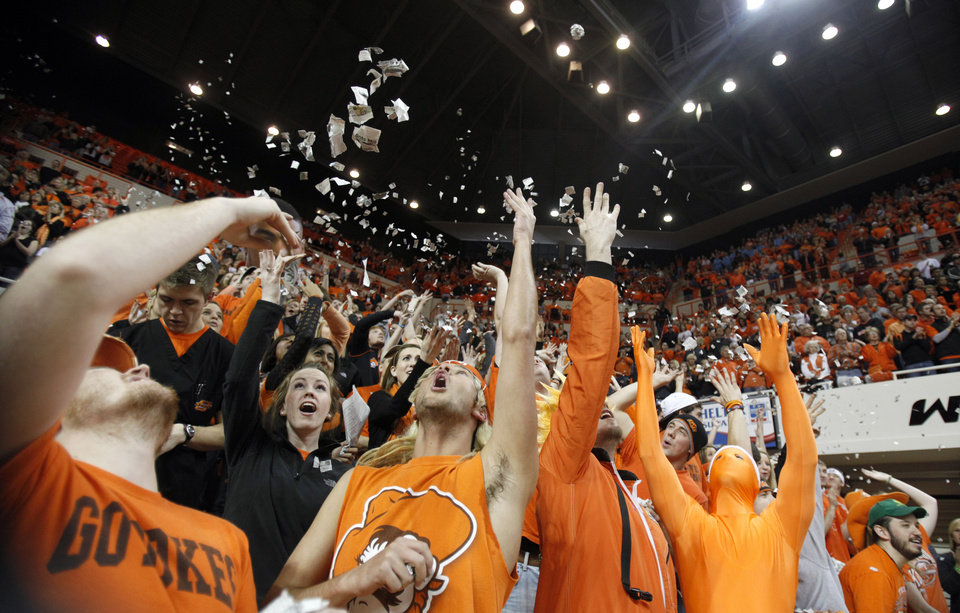 Photo - OSU fans cheer during the Bedlam men's college basketball game between the University of Oklahoma Sooners and Oklahoma State University Cowboys at Gallagher-Iba Arena in Stillwater, Okla., Saturday, February, 5, 2011. Photo by Sarah Phipps, The Oklahoman