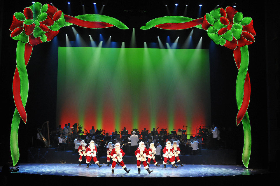 A line of dancing Santas at the Oklahoma City Philharmonic\'s