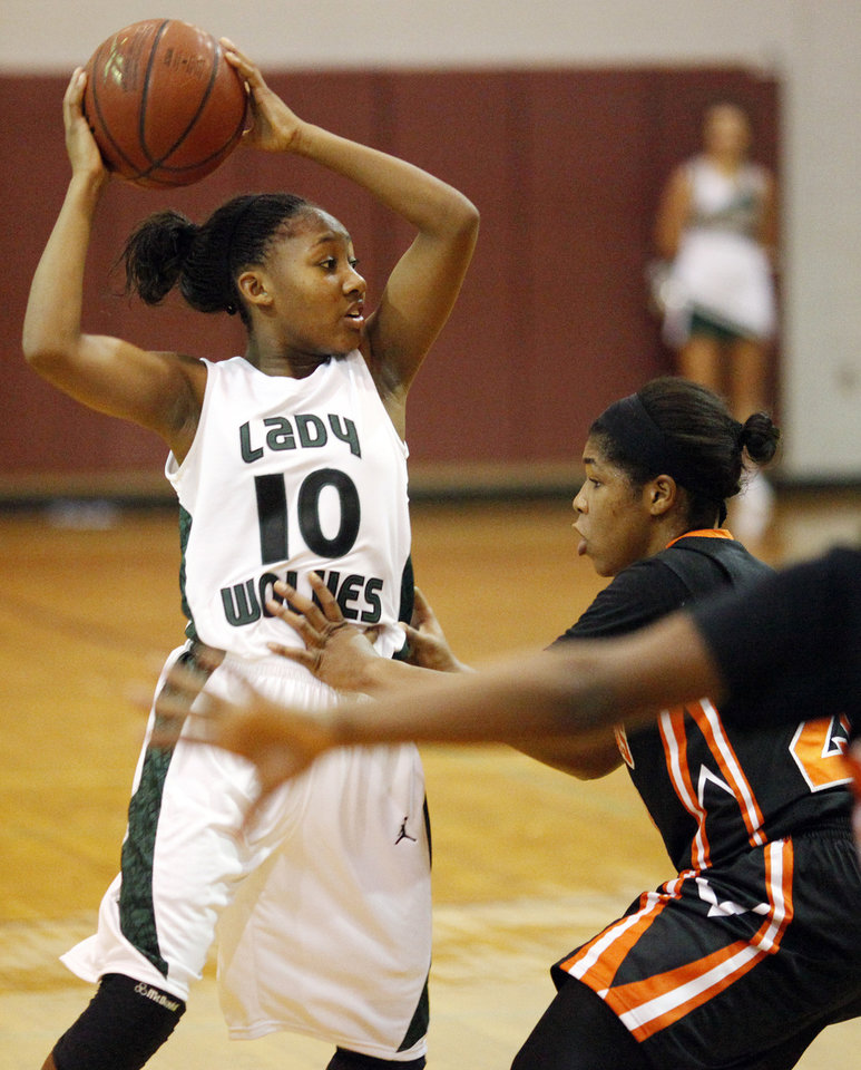 Edmond Santa Fe\'s Cameerah Graves (10) looks for a teammate to pass around defender Rachel Block (20) of Booker T. Washington during a girls high school basketball game between Edmond Santa Fe and Booker T. Washington from Tulsa in the 2011 Edmond Open Basketball Tournament at Edmond Memorial High School in Edmond, Okla., Friday, Dec. 9, 2011. Photo by Nate Billings, The Oklahoman
