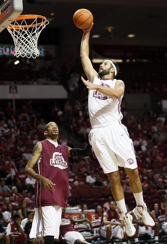 Photo - Beau Gerber takes the ball to the hoop as Kermit Holmes looks on during the OU Legends Alumni Game in Lloyd Noble Center in Norman, Okla., Saturday, Aug. 23, 2014. The game is part of the Sooner Basketball Family Weekend. Photo by Nate Billings, The Oklahoman