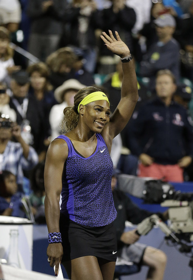 Photo - Serena Williams waves after beating Ana Ivanovic, from Serbia, during match in the Bank of the West Classic tennis tournament in Stanford, Calif., Friday, Aug. 1, 2014. Williams won 2-6, 6-3, 7-5. (AP Photo/Jeff Chiu)