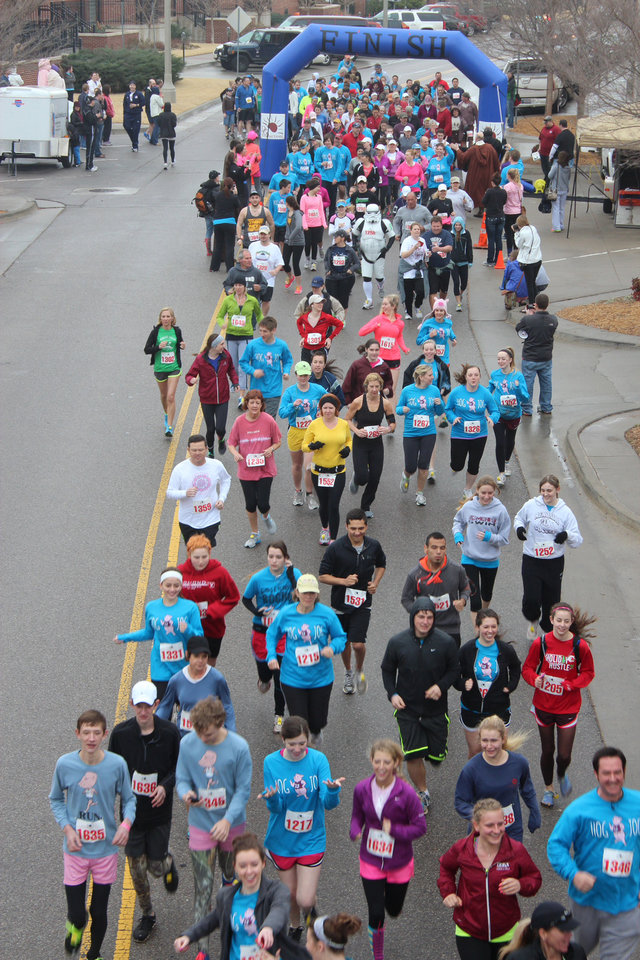 Left: Edmond Memorial High School�s first Swine Week Hog Jog 5k in Bricktown brought out 400 runners.