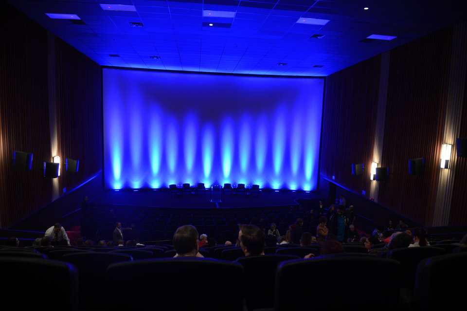 Photo - Guests take their seats at the Century Aurora cinema, formerly the Century 16, for a reopening and remembrance ceremony Thursday, Jan. 17, 2013 in Aurora, Colo. The cinema is where 12 people were killed and dozens injured in a shooting rampage last July. (AP Photo/The Denver Post, RJ Sangosti, Pool)