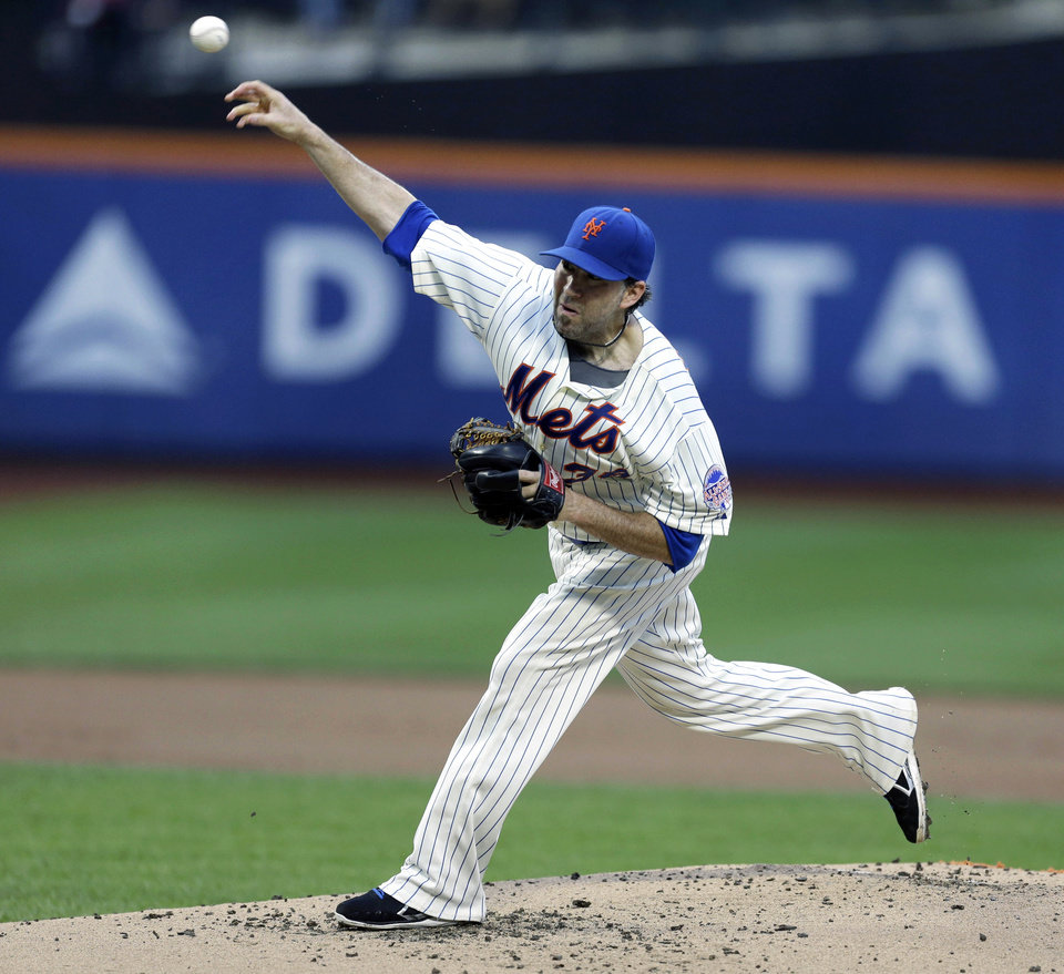 Photo - New York Mets starting pitcher Shaun Marcum works against the Arizona Diamondbacks during the first inning of the baseball game at Citi Field, Monday, July 1, 2013, in New York. (AP Photo/Seth Wenig)