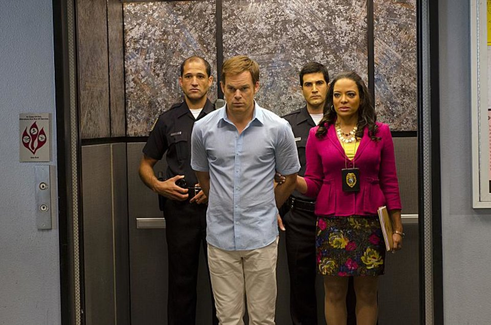 Michael C. Hall as Dexter Morgan and Lauren Velez as Maria LaGuerta in Dexter (Season 7, episode 12) - Photo: Randy Tepper/Showtime - Photo ID: dexter_712_0514