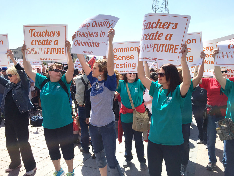 Photo - Teachers with Choctaw/Nicoma Park at the education rally at the Capitol sponsored by the Oklahoma Education Coalition Monday, March 30, 2015. Photo by Jim Beckel, The Oklahoman
