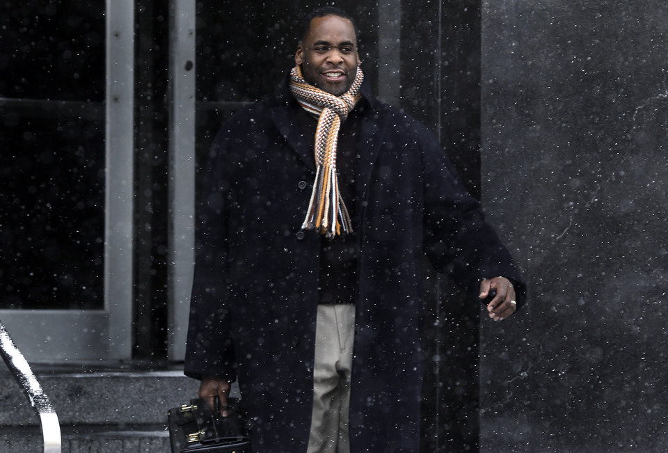 Photo - In this Jan. 25, 2013 file photo, former Detroit Mayor Kwame Kilpatrick leaves federal court in Detroit. A jury has convicted Kilpatrick, on Monday, March 11, 2013, on corruption charges after a five-month trial that portrayed him as a greedy politician who took bribes, fixed contracts and lived far beyond his salary. The verdict is another defeat for the man who left office in 2008 amid an unrelated scandal involving sexually explicit text messages and an affair with an aide. (AP Photo/Paul Sancya, File)
