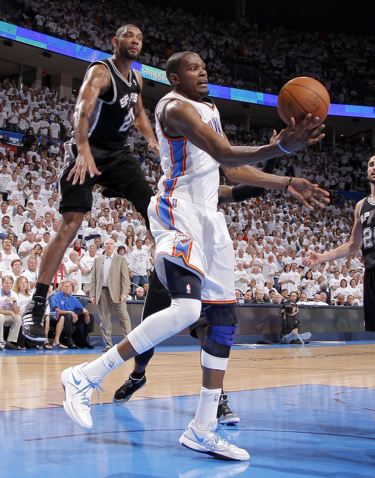 Photo - Oklahoma City's Kevin Durant (35) passes the ball beside San Antonio's Tim Duncan (21) during Game 6 of the Western Conference Finals between the Oklahoma City Thunder and the San Antonio Spurs in the NBA playoffs at the Chesapeake Energy Arena in Oklahoma City, Wednesday, June 6, 2012. Oklahoma City won 107-99. Photo by Bryan Terry, The Oklahoman