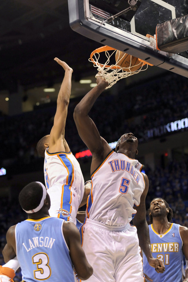 Oklahoma City\'s Kendrick Perkins tips in a shot in the fourth quarter of Sunday\'s game against Denver. The NBA said on Monday that the shot should not have counted. PHOTO BY JOHN LEYBA, THE DENVER POST