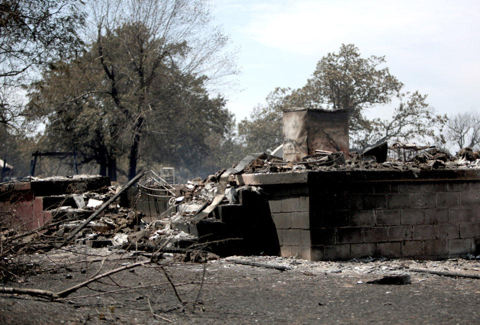 Photo - A home is pictured burned , Sunday, Aug. 5, 2012, in Oak Grove near Drumright, Okla., after wildfires moved through the area Saturday. Photo by Sarah Phipps, The Oklahoman