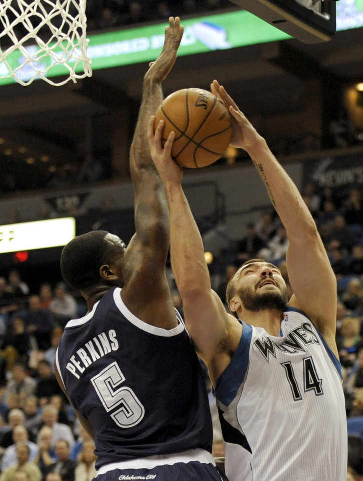 Photo - Minnesota Timberwolves' Nikola Pekovic (14), of Montenegro, shoots against Oklahoma City Thunder's Kendrick Perkins (5) during the first quarter of an NBA basketball game at the Target Center on Thursday, Dec. 20, 2012, in Minneapolis. (AP Photo/Hannah Foslien)