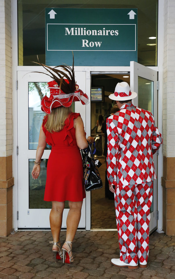 Photo - Spectators make their way to the grand stand viewing area before the 138th Kentucky Derby horse race at Churchill Downs Saturday, May 5, 2012, in Louisville, Ky. (AP Photo/James Crisp)  ORG XMIT: DBY128