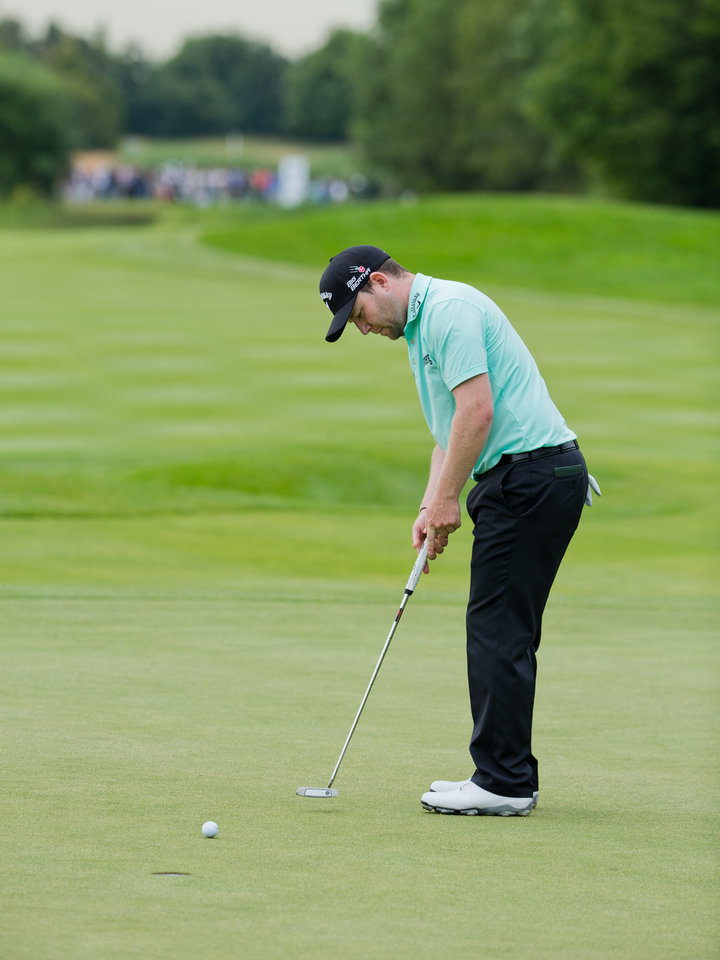 Photo - South Africa's Branden Grace  putts during the  BMW International Open golf tournament  in Pulheim near Cologne, Germany,  Friday June 27, 2014.  (AP Photo/dpa,Rolf Vennenbernd)