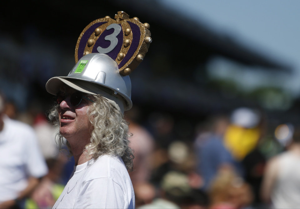Photo - A horse racing fan wears a homemade crown before the start of racing at Belmont Park in Elmont, New York, on Saturday, June 7, 2014, in New York. The crown is in recognition of Triple Crown favorite California Chrome. (AP Photo/Jason DeCrow)