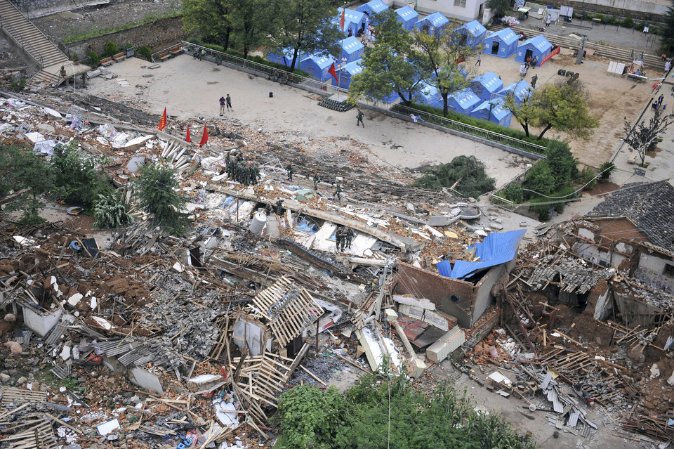 Photo - This photo released by China's Xinhua News Agency, shows the quake-hit Longtoushan Town of Ludian County in Zhaotong City, southwest China's Yunnan Province Monday, Aug. 4, 2014.  Rescuers dug through shattered homes Monday looking for survivors of the strong earthquake in southern China's Yunnan province that toppled thousands of homes on Sunday, killing hundreds and injuring more than a thousand people. (AP Photo/Xinhua, Xue Yubin) NO SALES