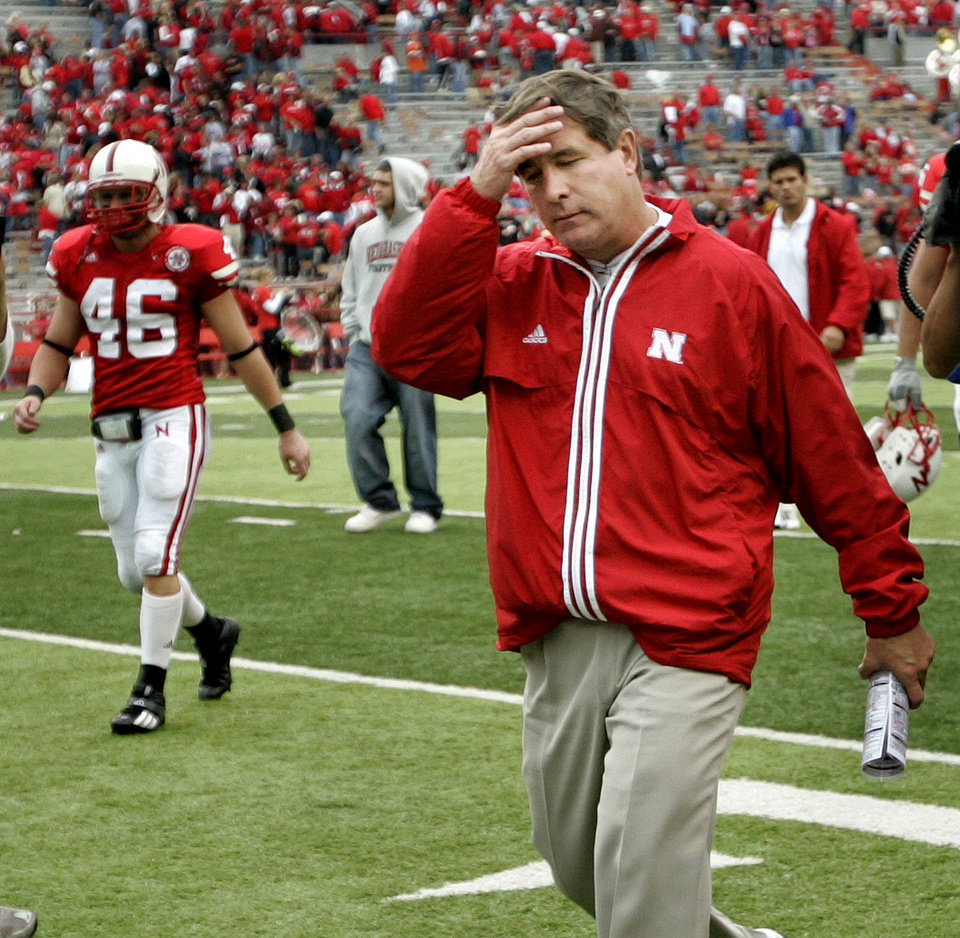 Photo - Nebraska coach Bill Callahan walks off the field after their loss in the college football game between Oklahoma State University (OSU) and the University of Nebraska at Memorial Stadium in Lincoln, Neb., on Saturday, Oct. 13, 2007. By Bryan Terry, The Oklahoman