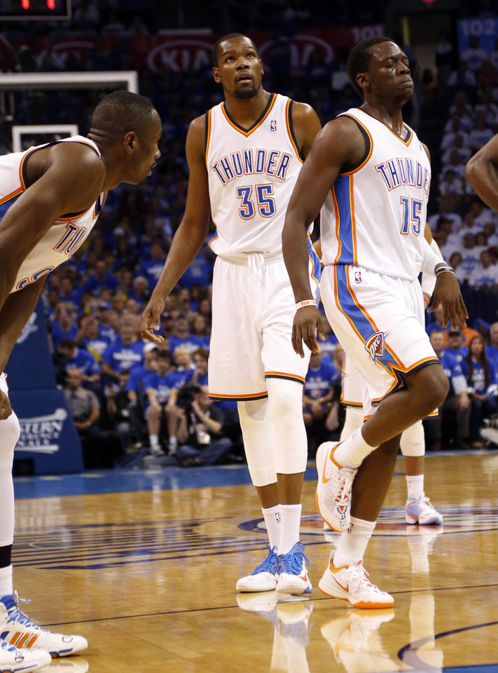 Photo - Oklahoma City's Reggie Jackson (15) reacts after an ankle injury during Game 4 of the Western Conference Finals in the NBA playoffs between the Oklahoma City Thunder and the San Antonio Spurs at Chesapeake Energy Arena in Oklahoma City, Tuesday, May 27, 2014. Photo by Nate Billings, The Oklahoman