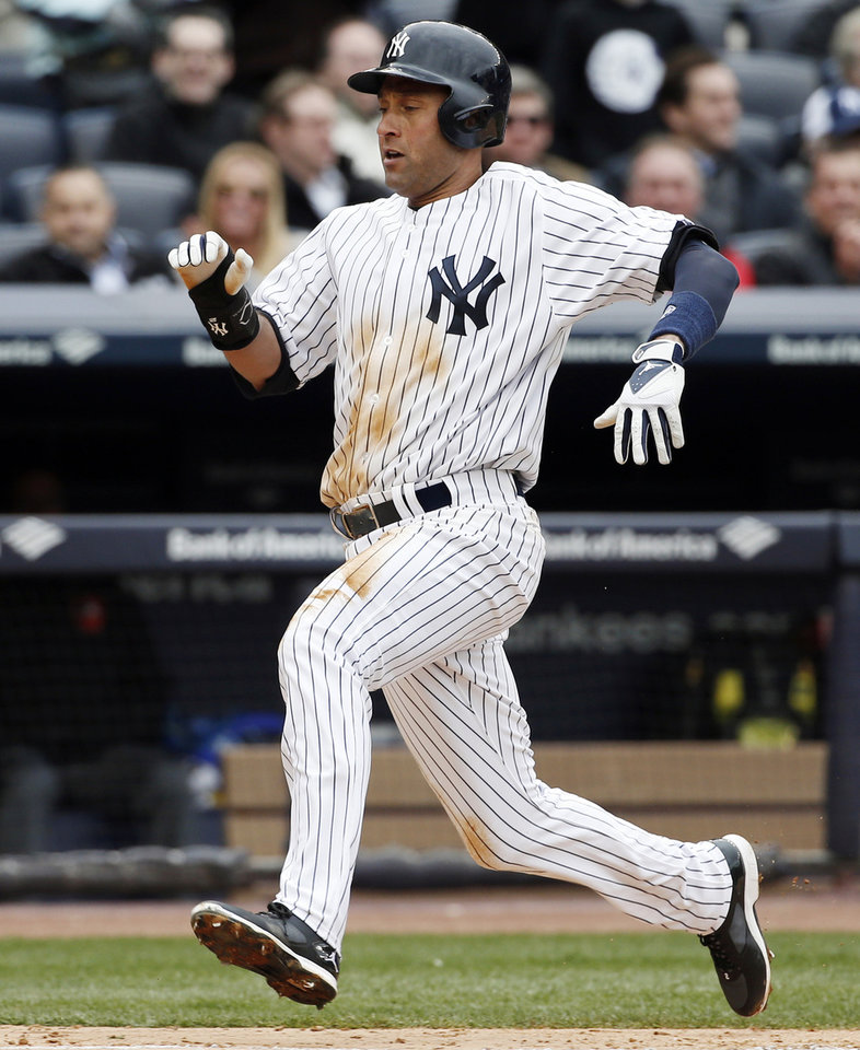 Photo - New York Yankees Derek Jeter runs in to score on Jacoby Ellsbury's fifth-inning, RBI single in a baseball game during the Yankees home opener against the Baltimore Orioles, at Yankee Stadium in New York, Monday, April 7, 2014. (AP Photo/Kathy Willens)