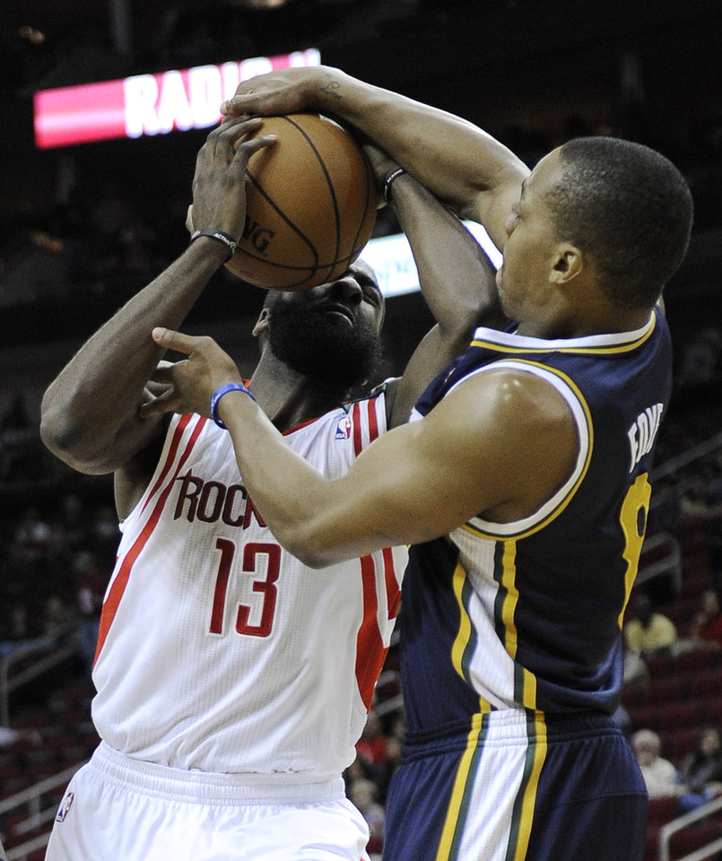 Photo - Utah Jazz's Randy Foye (8) tries to grab the ball from Houston Rockets' James Harden (13) in the first half of an NBA basketball game on Saturday, Dec. 1, 2012, in Houston. (AP Photo/Pat Sullivan)