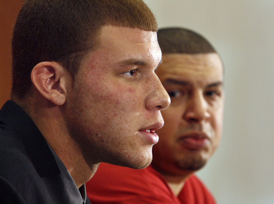 Photo - University of Oklahoma basketball star Blake Griffin announces he will leave the Sooner team for the NBA professional draft in Norman, Okla. on Tuesday, April 7, 2009.   At right is Sooner head coach Jeff Capel.