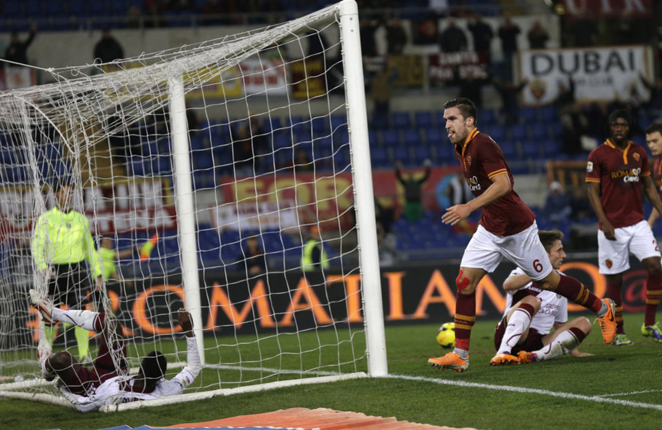 Photo - AS Roma midfielder Kevin Strootman of Belgium , right, celebrates after scoring  during an Italian Serie A soccer match between AS Roma and Livorno at Rome's Olympic stadium, Saturday, Jan. 18, 2014. (AP Photo/Alessandra Tarantino)