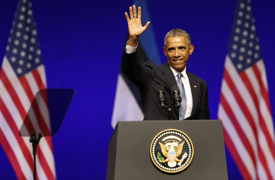 Photo - U.S. President Barack Obama waves after speaking at Nordea Concert Hall in Tallinn, Estonia, Wednesday, Sept. 3, 2014. Obama is in Estonia for a one-day visit where he will meet with Baltic State leaders before heading to the NATO Summit in Wales. (AP Photo/Mindaugas Kulbis)