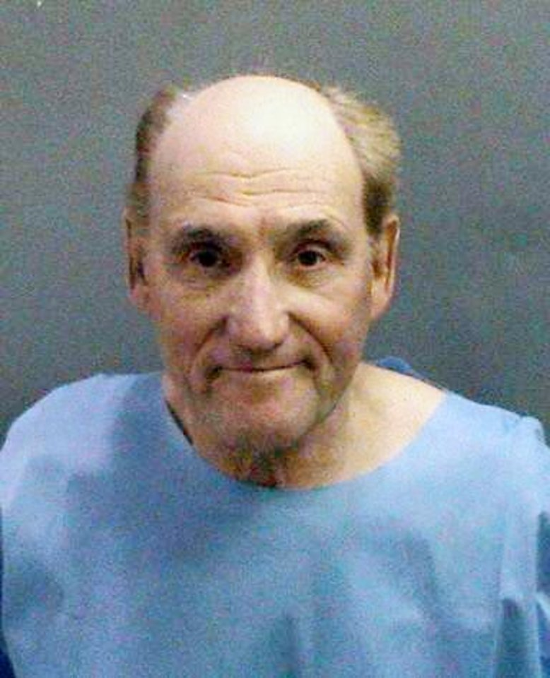 Photo - This photo released Tue. Jan. 29, 2013 by the Orange County Sheriff's Department showing Stanwood Fred Elkus, 75, of Lake Elsinore who was arrested Monday, Jan. 28,2013, suspected of killing Dr. Ronald Franklin Gilbert, 52, of Huntington Beach at the medical office in Orange County on Monday Jan. 28,2013. (AP Photo/Orange County Sheriff's Department)