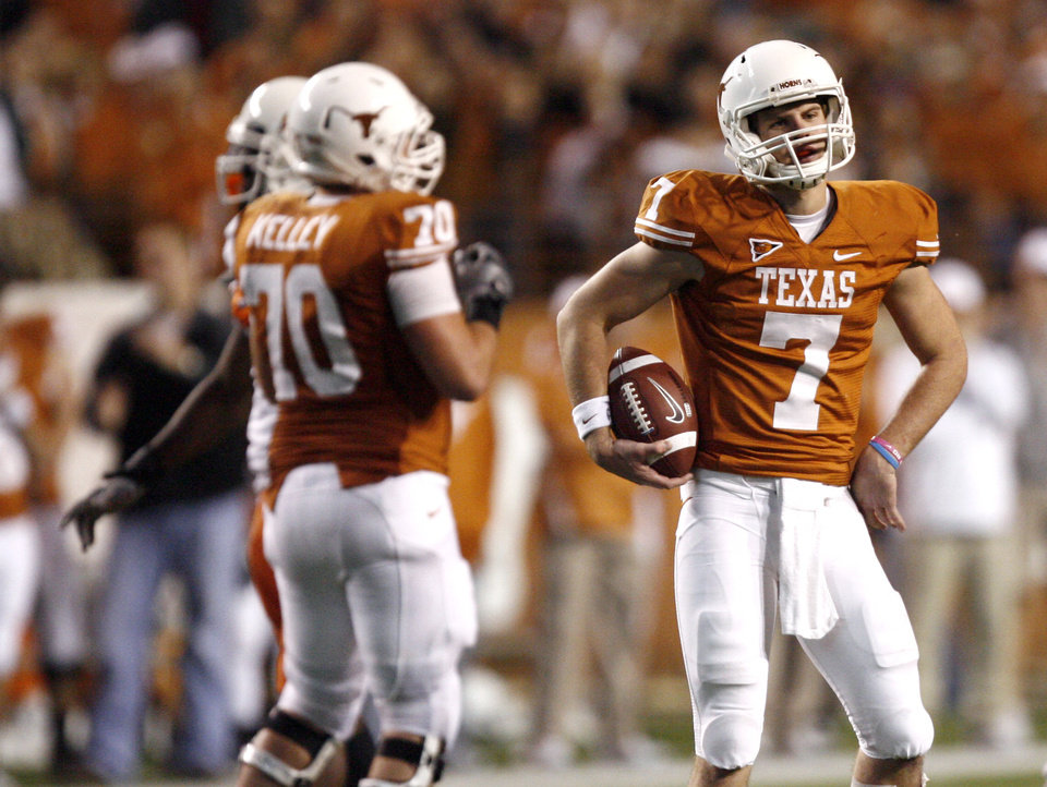 Photo - Texas' Garrett Gilbert (7) reacts to a call during the college football game between the Oklahoma State University Cowboys (OSU) and the University of Texas Longhorns (UT) at Darrell K Royal-Texas Memorial Stadium in Austin, Texas, Saturday, November 13, 2010. Photo by Sarah Phipps, The Oklahoman