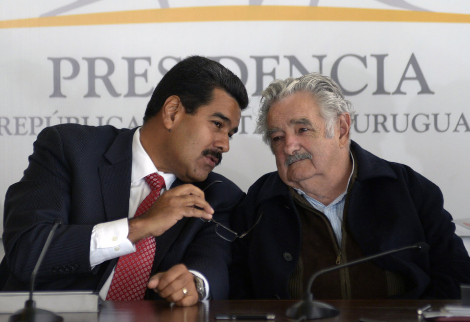 Photo - Venezuela's President Nicolas Maduro, left, speaks with Uruguay's President Jose Mujica during a press conference at the presidential residence in Montevideo, Uruguay, Tuesday, May 7, 2013. Maduro is on a one-day official visit to Uruguay. (AP Photo/Matilde Campodonico)