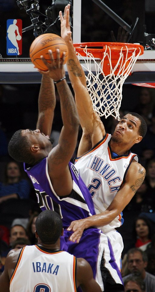 Oklahoma City's Thabo Sefolosha (2) blocks the shot of Sacramento's Donte Greene (20) in front of Serge Ibaka (9) of Oklahoma City during the NBA preseason game between the Sacramento Kings and the Oklahoma City Thunder at the Ford Center in Oklahoma City, Thursday, Oct. 22, 2009. Sacramento won, 104-89. Photo by Nate Billings, The Oklahoman
