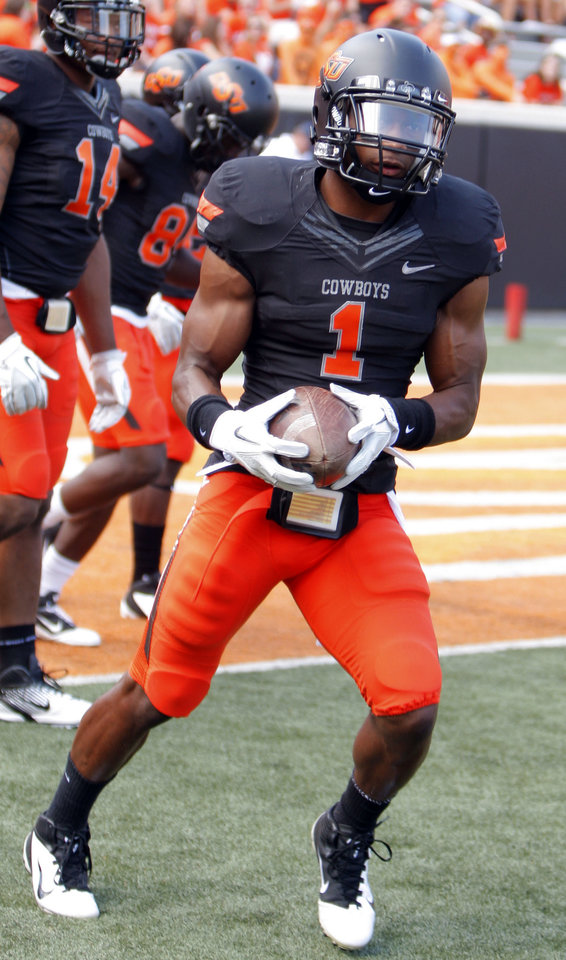 Oklahoma State's Joseph Randle (1) warms up before a college football game between the Oklahoma State University Cowboys (OSU) and the University of Kansas Jayhawks (KU) at Boone Pickens Stadium in Stillwater, Okla., Saturday, Oct. 8, 2011. Photo by Sarah Phipps, The Oklahoman