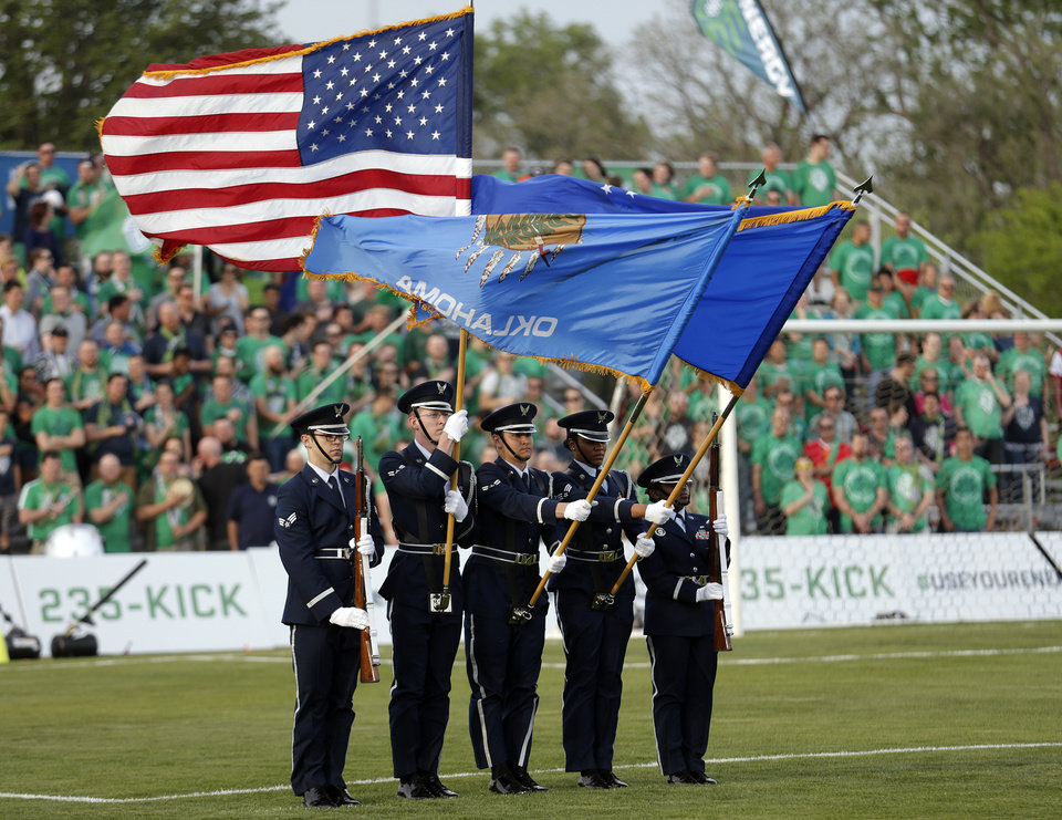 Photo - A honor guard presents the color before the OKC Energy FC soccer game against Orlando City SC at Pribil Stadium in Oklahoma City, Saturday, April 26, 2014. Photo by Sarah Phipps, The Oklahoman