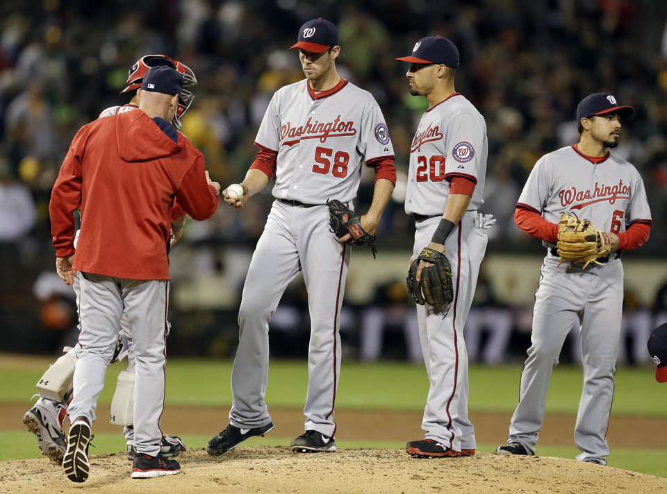 Photo - Washington Nationals' Doug Fister (58) hands the ball to manager Matt Williams as Fister is removed from the baseball game against the Oakland Athletics in the fifth inning Friday, May 9, 2014, in Oakland, Calif. (AP Photo/Ben Margot)
