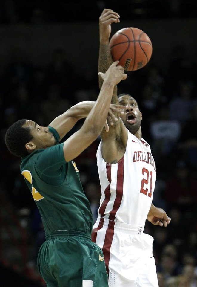 Photo - Oklahoma's Cameron Clark (21) forces a turnover from North Dakota State's Lawrence Alexander (12) during the NCAA men's basketball tournament game between the University of Oklahoma and North Dakota State at the Spokane Arena in Spokane, Wash., Thursday, March 20, 2014. Oklahoma home lost 80-75. Photo by Sarah Phipps, The Oklahoman