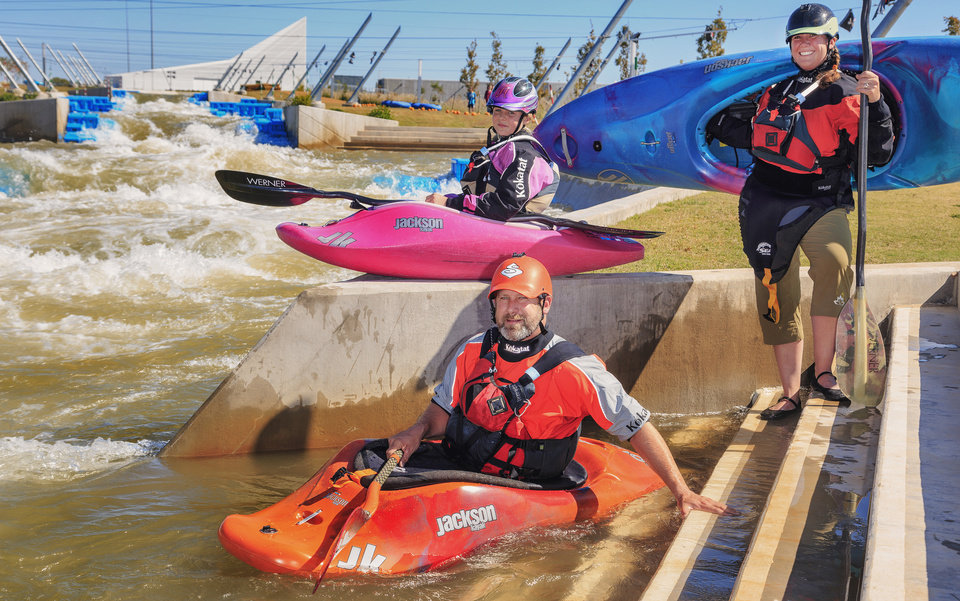 Photo - Abby, 12, Peter, and Kathy Holcombe, from left, pose for a photo during their kayak adventure at the Riversport Rapids in Oklahoma City, Okla., Friday, Oct. 21, 2016. Peter and Kathy decided two years ago to sale their home in Boulder, Colo., to live on the road with their daughter Abby kayaking, hiking and rock-climb across America.  Photo by Chris Landsberger, The Oklahoman